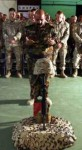 "Iraqi Army Lt. Col. Abbas Jabbar Abbas Al Amari, commanding officer of the 2nd Battalion, 2nd Brigade, 7th Iraqi Army Division, pays his respects to Staff Sgt. Jason C. Ramseyer, who was killed April 20, 2006 in a roadside blast in Haditha, Iraq. Marines and sailors from the Hawaii-based battalion held a memorial for him April 23, 2006, at their base at Haditha, Iraq. Ramseyer served as the platoon commander for the battalion's Forward Command Post, also known as the ""Jump CP."" His job often required him to travel on Al Anbar's dangerous roads to provide security for Iraqis and other Marines. The 28-year-old was remembered as a committed leader and devout family man by those who served with him. Ramseyer, who served with the battalion in Afghanistan last year, is survived by his wife, Amanda and his three children, Caleb, Cadence and Riley. Photo by: Sgt. Roe F. Seigle"